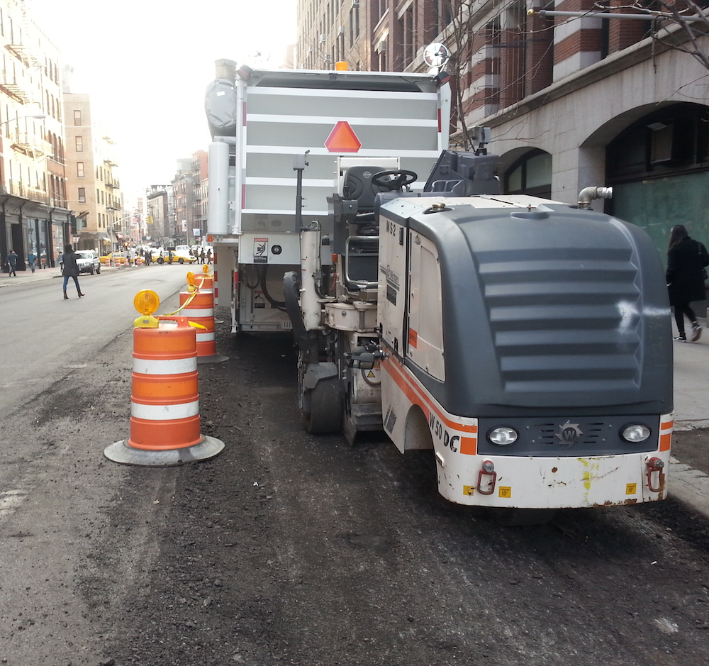 Crews have already begun work on a repaving project that will include a protected bike lane on Lafayette Street and Fourth Avenue. Photo: Stephen Miller
