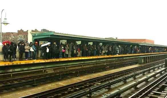 Straphangers pack a subway platform in Queens this morning. The $30 million Governor Cuomo diverted from the MTA budget could have been used to address subway overcrowding. Photo: ##https://twitter.com/lreynolds21363/status/450610751632588800##@lreynolds21363## via ##http://gothamist.com/2014/03/31/mta_is_trying_to_break_your_heart.php##Gothamist##