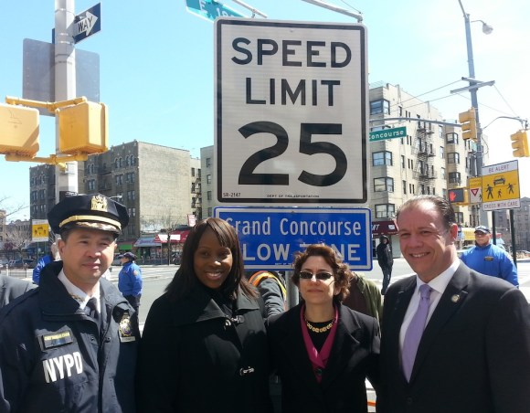 """NYPD Chief of Transportation Thomas Chan, Council Member Vanessa Gibson, Transportation Commissioner Polly Trottenberg and Assembly Member Mark Gjonaj unveil the city's second """"arterial slow zone"""" this morning. Photo: Stephen Miller"""