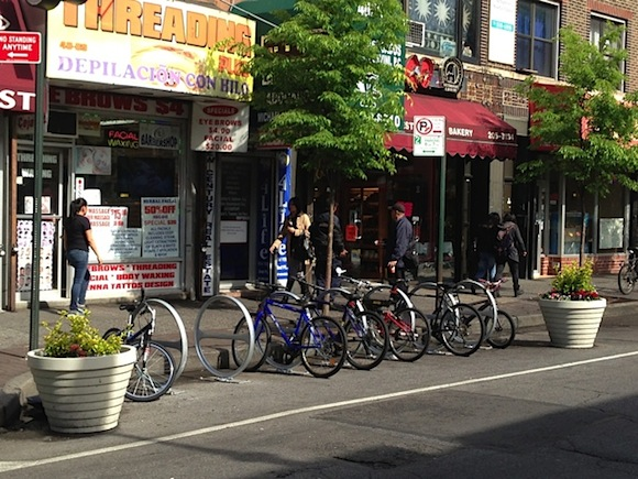 Jackson Heights is one of many NYC neighborhoods that survived the installation of bike corrals. Photo: Clarence Eckerson Jr.