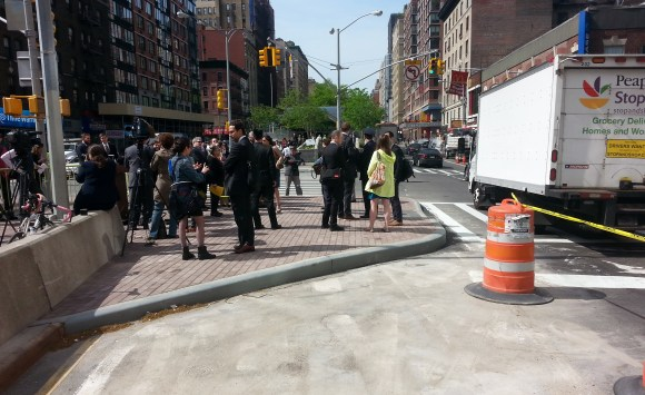 Press gathers this morning on an expanded pedestrian island at 96th Street and Broadway that, until recently, had been a left turn lane. Photo: Stephen Miller