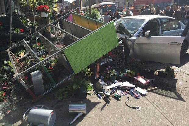 Two people were injured after a driver jumped the curb in the East Village, slamming into a hardware storefront. Photo: Twitter/@wlodarczyk