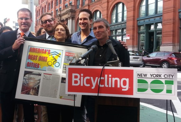 Bicycling Magazine publisher Zachary Grice, left, awards DOT Commissioner Polly Trottenberg, center, with recognition of New York City as America's best city for biking. They are joined by Transportation Alternatives executive director Paul Steely White, second from left, Bike New York executive director Kenneth Podziba, second from left, and Bicycling Magazine Editor-in-Chief Bill Strickland, left. Photo: Stephen Miller