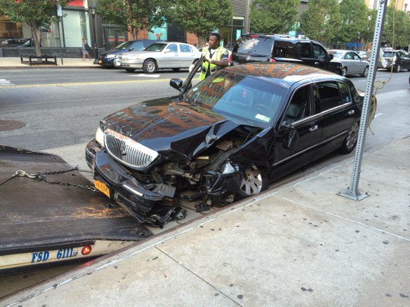 A livery cab driver jumped the curb on Atlantic Avenue after colliding with the driver of a flatbed truck, striking a pedestrian on the sidewalk and crushing her leg. The truck driver was summonsed for an improper turn and other violations, according to the TLC. The cab driver was not ticketed or charged. Photo: Sarah Goodyear