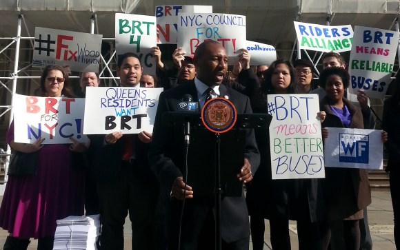 Council Member Donovan Richards calls for center-running Bus Rapid Transit on Woodhaven and Cross Bay Boulevards at City Hall this morning. Photo: Stephen Miller