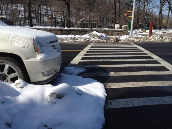 Parking at the edge of a crosswalk hinders visibility but is condoned under city traffic rules. Photos: Brad Aaron