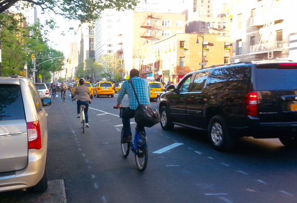 Buffers are nice, but fall far short of a complete street with a protected bike lane. Photo: Stephen Miller