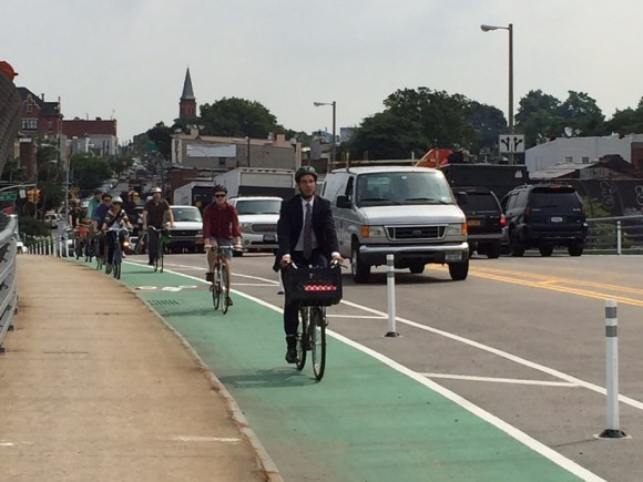Cyclists, led by DOT Assistant Commissioner Ryan Russo, ride over the newly-completed Greenpoint Avenue Bridge bike lanes. Photo: Clarence Eckerson Jr.