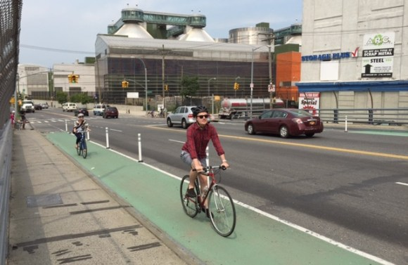 The plastic bollards continue even when the bike lane buffer disappears. Photo: Clarence Eckerson Jr.
