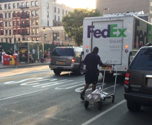 FedEx likely isn't paying a dime for double parking. Photo: Stephen Miller