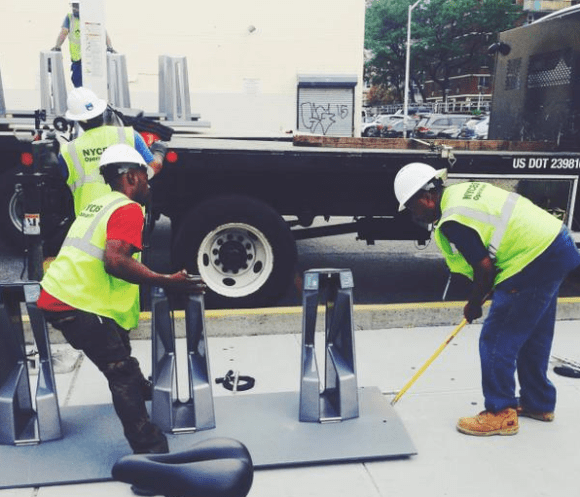 A Citi Bike crew installs a station at Broadway and Boerum Street. Photo: Citi Bike/Twitter