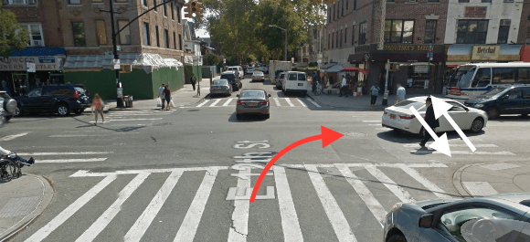 The white arrow indicates the approximate path of Lubov Brodskaya - it's unknown if she was walking north or south - and the red arrow indicates the approximate path of the FedEx driver who killed her at E. 12th Street and Avenue J. Image: Google Maps