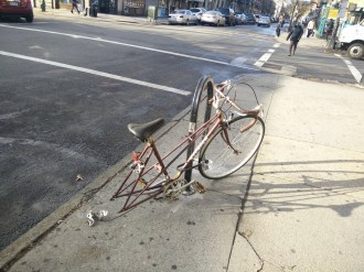 This abandoned bike on Nostrand does not meet the city's current criteria for removal. Photo: David Meyer