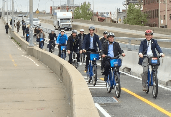 State Senator Martin Malavé Dilan and City Council Majority Leader Jimmy Van Bramer lead the pack of DOT officials, electeds and advocates on the Pulaski Bridge protected lane's first official ride. Photo: David Meyer