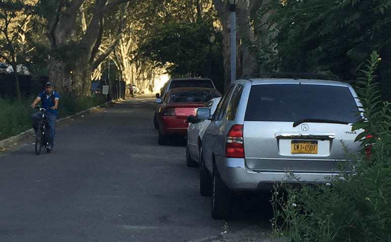 NYC Parks said it is aware that this segment of the Queensbridge Park Greenway has become a haven for illegal parking. Photo: David Meyer