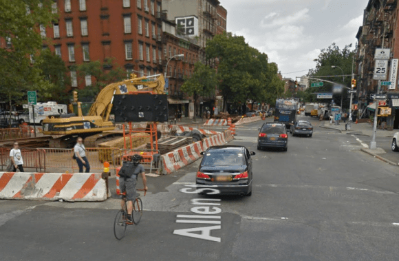 For years, cyclists crossing East Houston Street between the Allen Street and First Avenue protected lanes were forced into traffic by construction zones. Photo: Google Maps