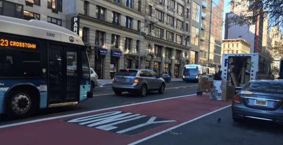 A delivery truck forced this bus out of 23rd Street's dedicated bus lanes. Photo: David Meyer