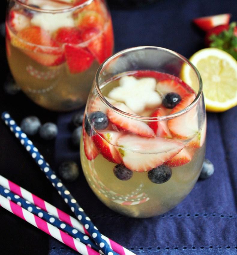 Strawberries, pears, and blueberries boasted by Moscato, tonic water, lemon juice and a gentle touch of gin make the perfect white sangria for 4th of July!