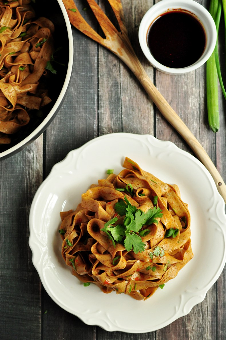 These mouthwatering spicy Chinese noodles are the most savory and irresistible noodles you'll ever have. Guess how many ingredients this recipe requires? Only six! Make the hot chili oil ahead and whip up the noodle sauce in no time.