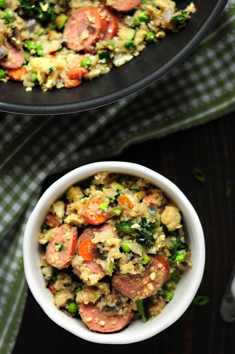 Cauliflower rice fried with loads of vegetables, eggs, mushrooms and kielbasa in a tasty gluten-free sauce. It's a super savory low-carb meal you can put together for your whole family in just 30 minutes.