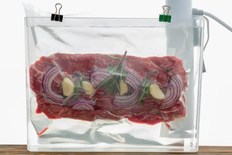 Vacuum sealed flank steak in a sous vide water bath