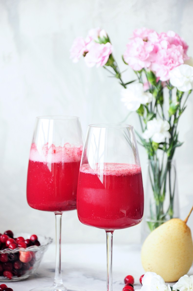 This fresh pear and cranberry mocktail is healthy, full of flavor, and lower in sugar than most fruity drinks. Perfect for the holidays or girls' nights in.