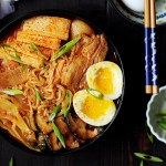 This epic kimchi ramen features pork belly, shiitake mushrooms, bok choy, tofu, and kimchi! The best part is that it's one pot and only takes 30 minutes!