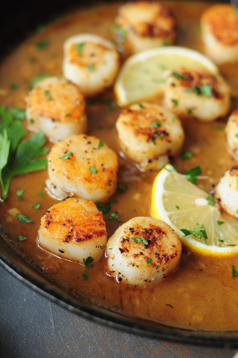 Perfectly pan-seared scallops served with a lemon butter sauce... this scallop recipe is the easiest gourmet dish you can make on a weeknight in just 15 minutes.