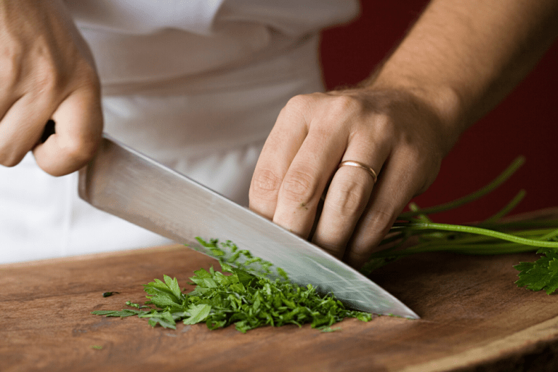 chopping fresh parsley