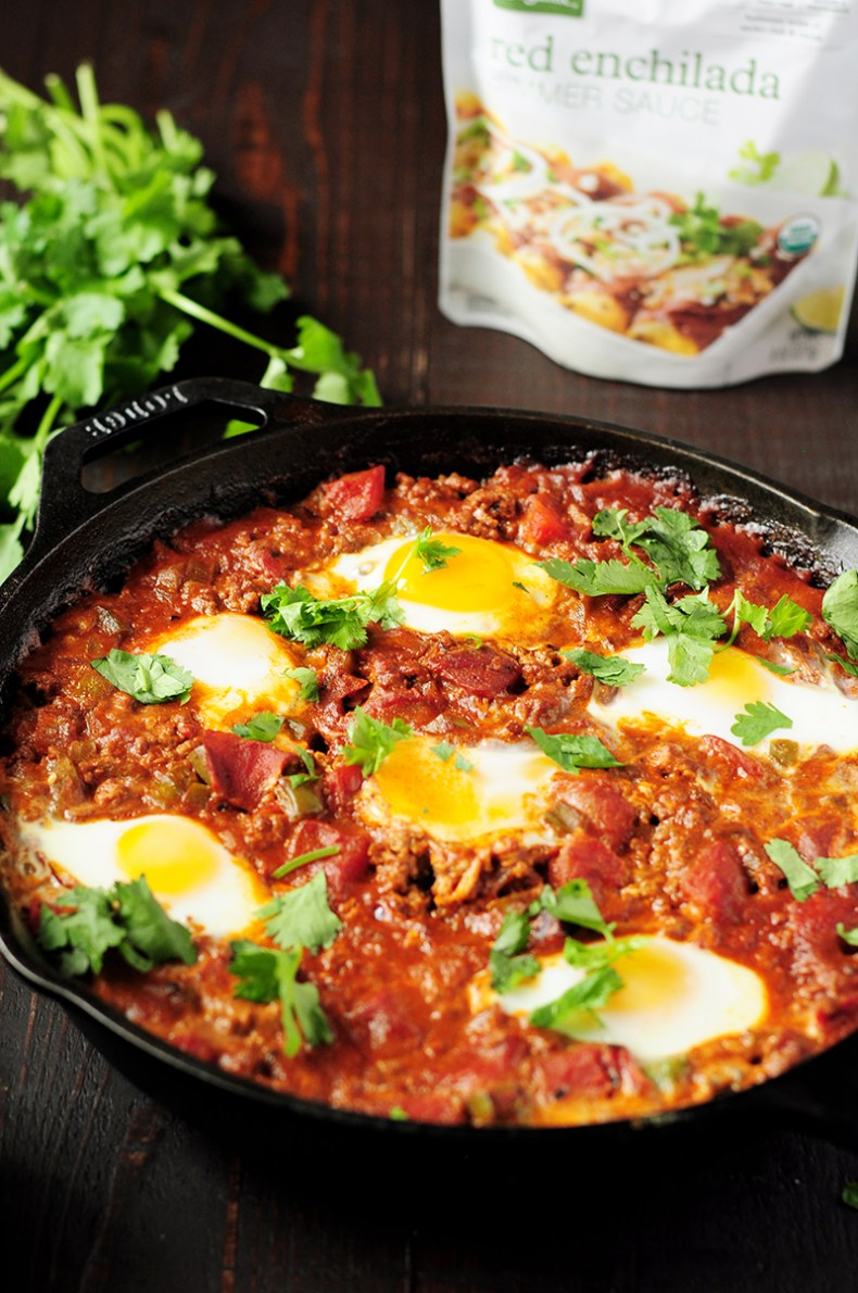 Easy 7-ingredient Shakshuka recipe simmered in a tangy, aromatic red chili sauce with rich notes of cocoa, smoked paprika, and ancho chili.