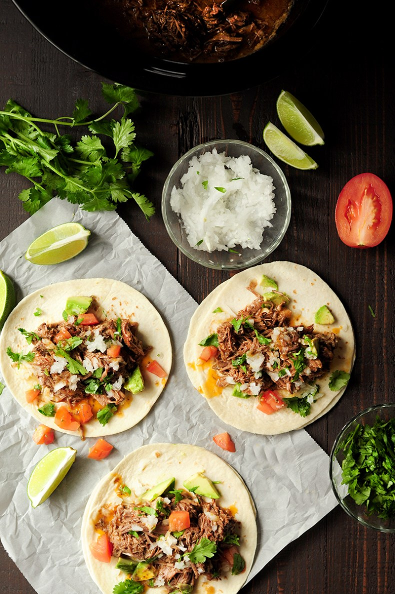 This beef barbacoa recipe takes five minutes of hands-on time and will yield the best tasting, melt-in-your-mouth-tender tacos you've ever made at home.