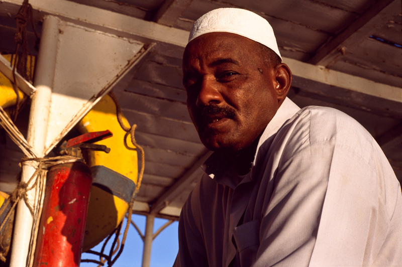 "Aside from not speaking Spanish, I definitely don't know any Sudanese. This boat captain was from Sudan, working in southern Egypt. When I showed him the camera he lifted his eye brows, as if to say, ""Well as long as it doesn't hurt too much, fire away."""