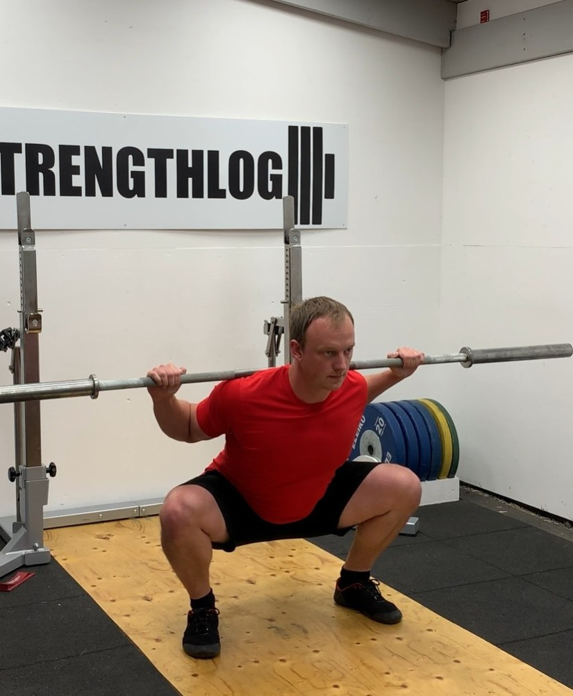 Powerlifting style low bar squat