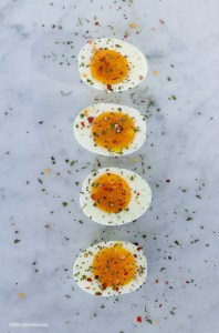 Soft boiled eggs sprinkled with parsley and red & black pepper | StrictlyDelicious.com