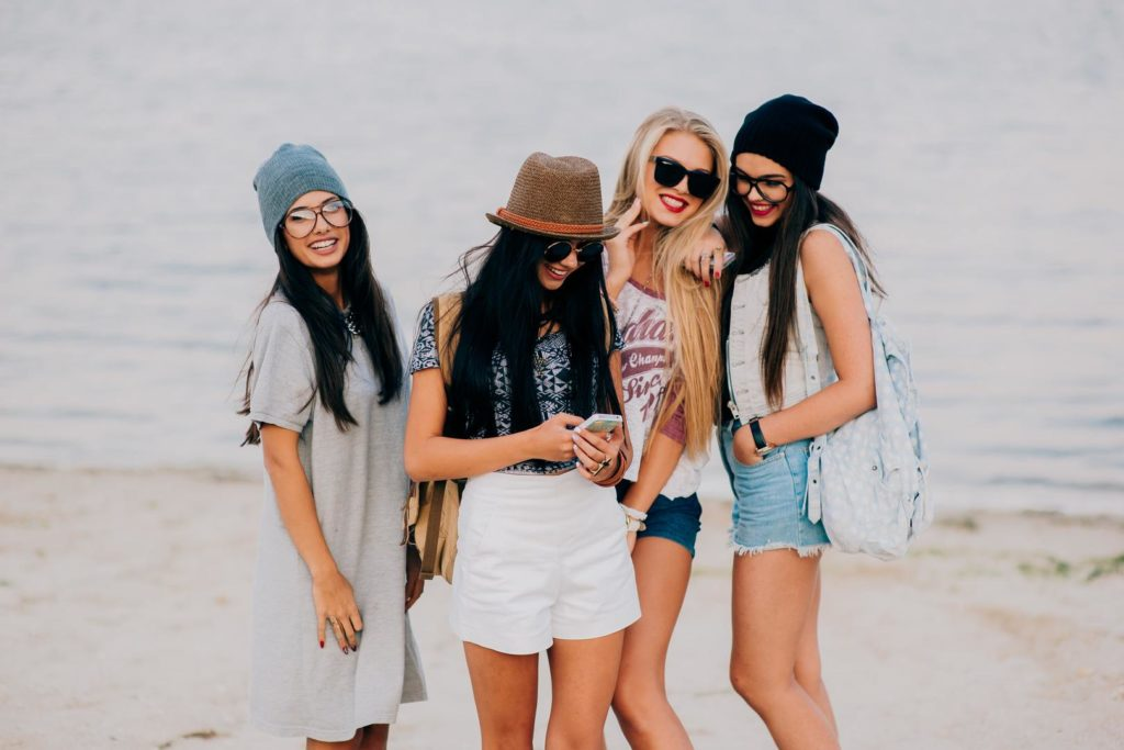 Four young girls on the beach