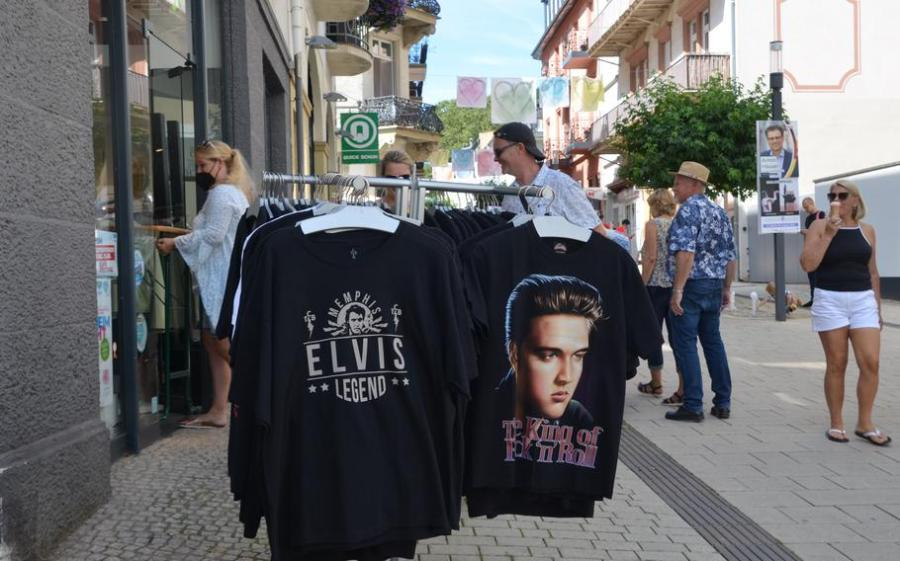 Elvis Presley T-shirts are for sale outside a shop in Bad Nauheim, Germany, August 15, 2021. The spa town hosts the European Elvis Festival in August, in tribute to Presley, who lived in Bad Nauheim from 1958-1960 when he was a private in the U.S. Army.