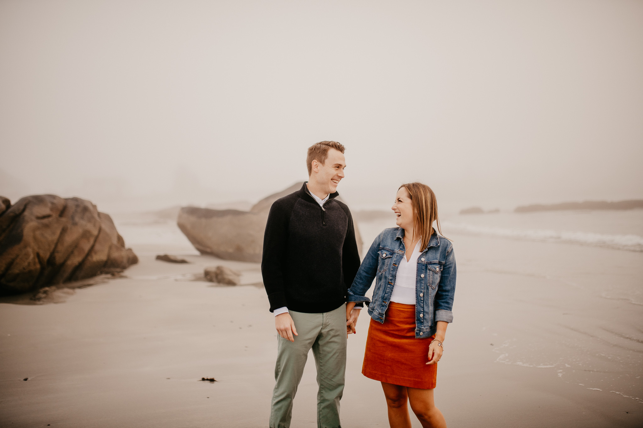 Couple laughing on the beach. Maine engagement photos. Beach engagement photos. Preppy engagement photos.