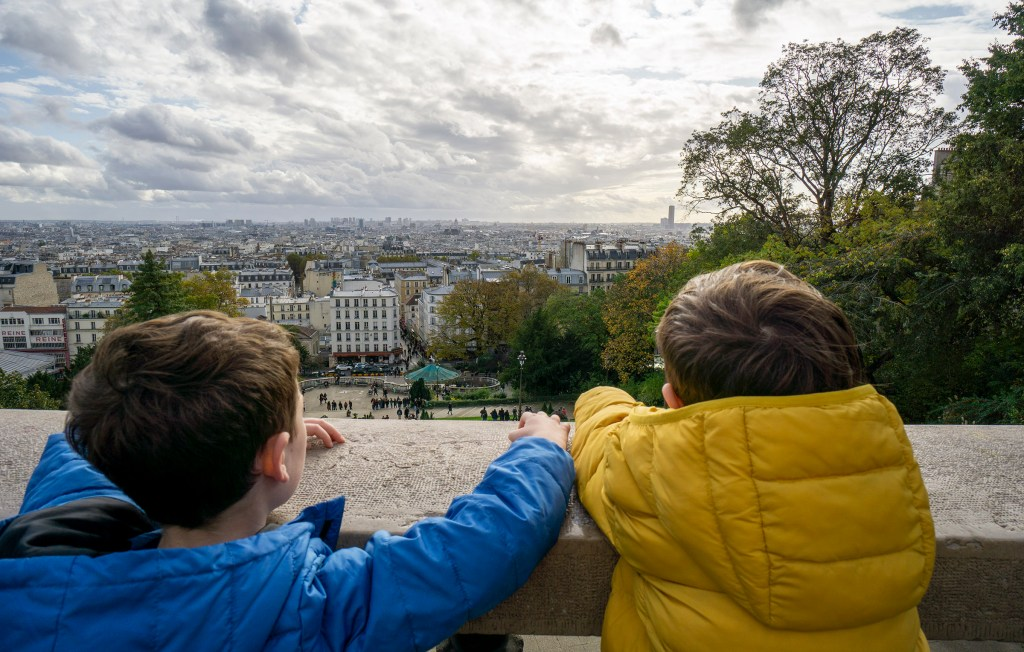 Children looking out over Paris from Montmartre hill.