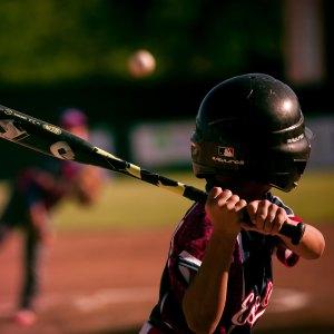 A boy swinging a baseball bat