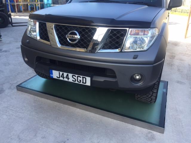 drive on glass floor panel
