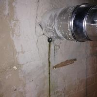 "Q&A: ""Why does water leak through the bottom of my chimney?"""