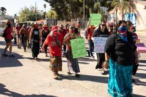 Kumeyaay warriors march to Tecate border crossing on Indigenous Peoples Day