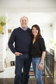Chip and Dana Brown standing in their home together.