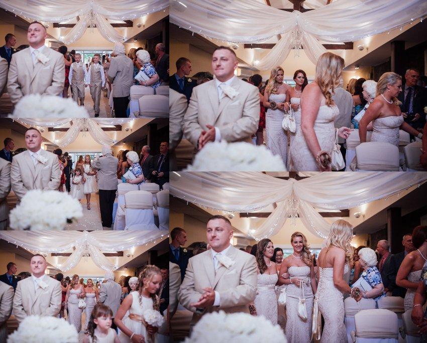 bridesmaids walk up the aisle