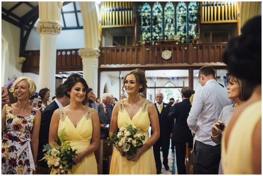 bridesmaid waking aisle