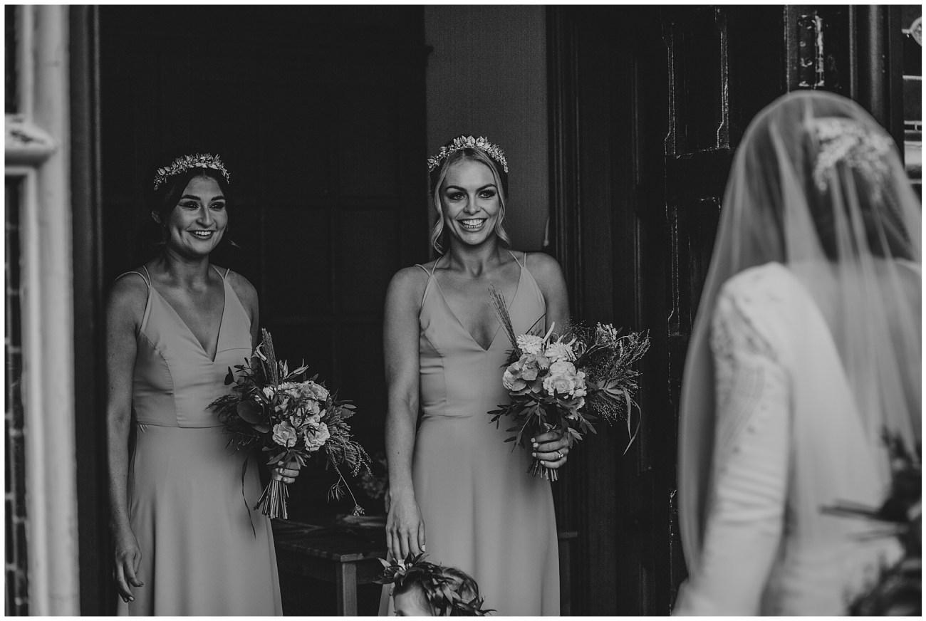 bridesmaids welcoming bride