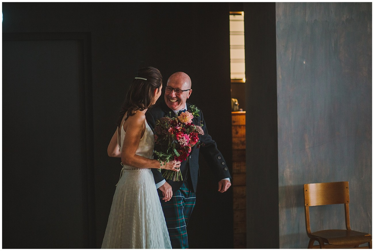 father of bride smiling at bride