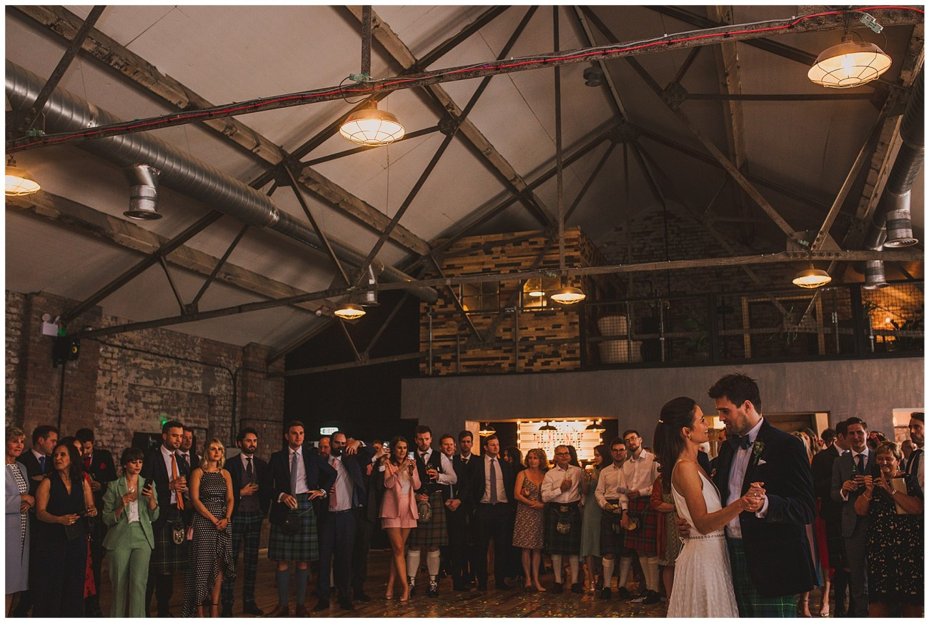 wide angle bride and groom first dance