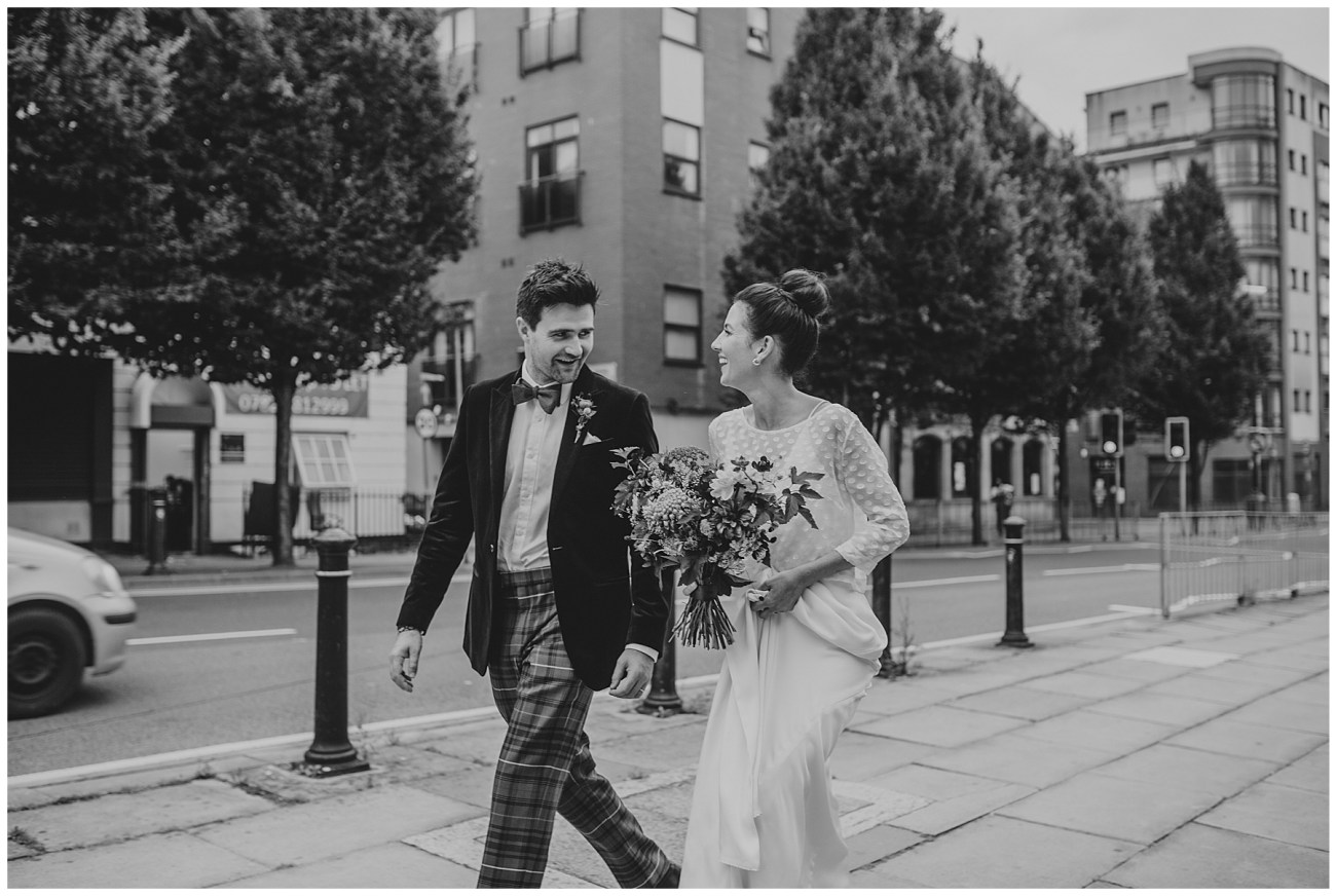bride and groom walking the street of liverpool