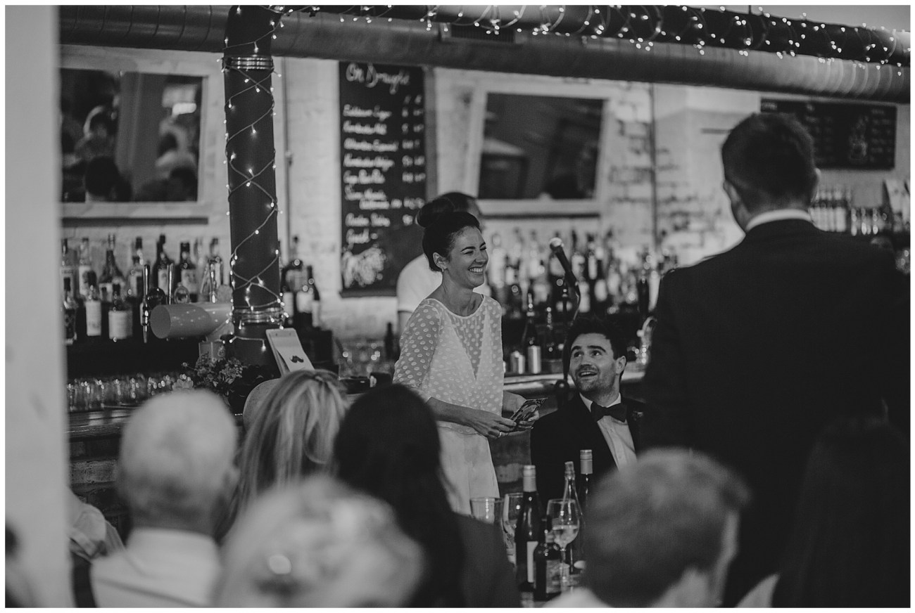 bride doing speech in black and white